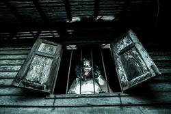 Horror woman in window wood looking camera scary scene halloween thai ghost concept