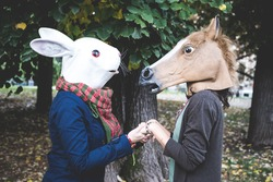 horse and rabbit mask women in the park autumn