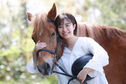 Horse and smiling woman riding image