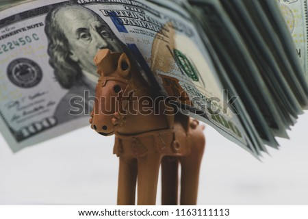 Horse and US dollar bill. Horse racing concept. Gambling concept.