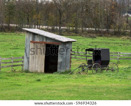 Horse Buggy Parked by Old Shed on Amish Farm