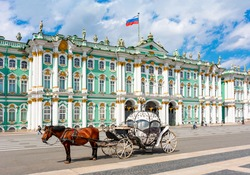 Horse carriage on Palace square and Hermitage museum at background, St. Petersburg, Russia