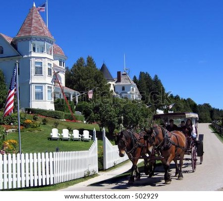 Horse-drawn carriage and cottage on Mackinac Island, Michigan