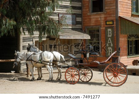 Horse-drawn carriage in a traditional American western town