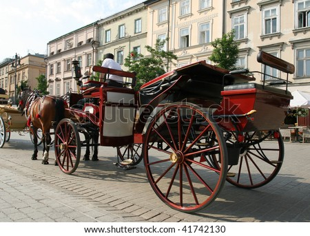 Horse drawn carriage - tourist attraction at Krakow City Square. Poland.