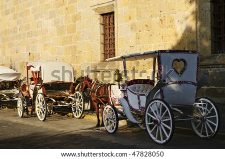 Horse drawn carriages waiting for tourists in historic Guadalajara, Jalisco, Mexico