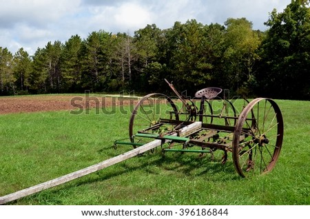 Horse drawn plow with seat and two wheels - Shutterstock ID 396186844