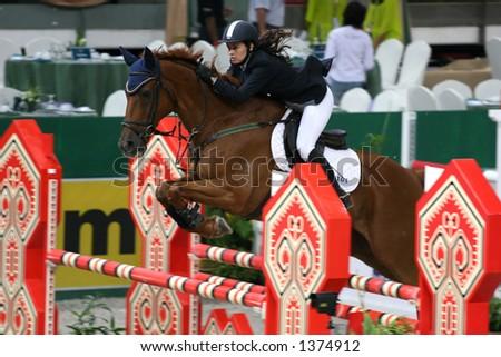 Horse jumping in indoor stadium in Kuala Lumpur