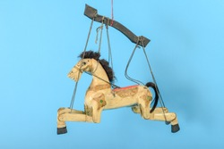 Horse puppet isolated on blue background