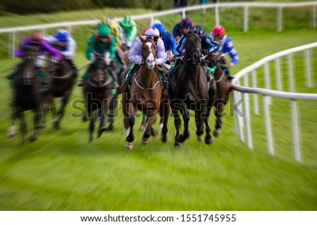 Horse racing action motion blur zoom effect on the turn of the race track #1551745955