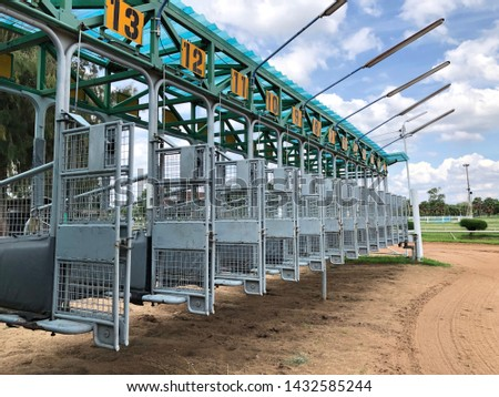 Horse racing starting gate at racesourse. #1432585244