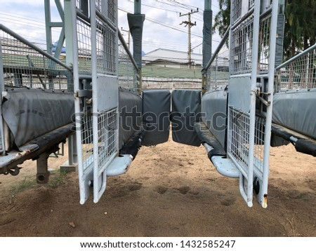 Horse racing starting gate at racesourse. #1432585247