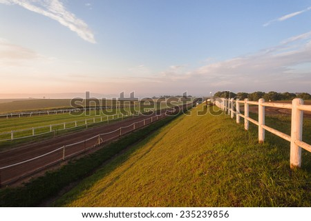 Horse Racing Tracks  Horse racing training tracks sand and grass landscape in morning sunrise colors