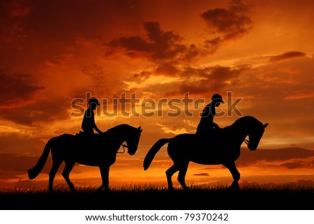 horse riders in the sunset