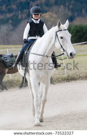 horseback riding quotes. horse riding girl. stock photo