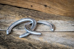 Horse shoes on wooden table