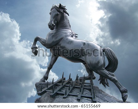 horse statue on the sky with clouds