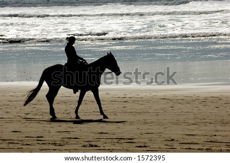 Horseback riding on Cannon beach, Oregon coast, USA