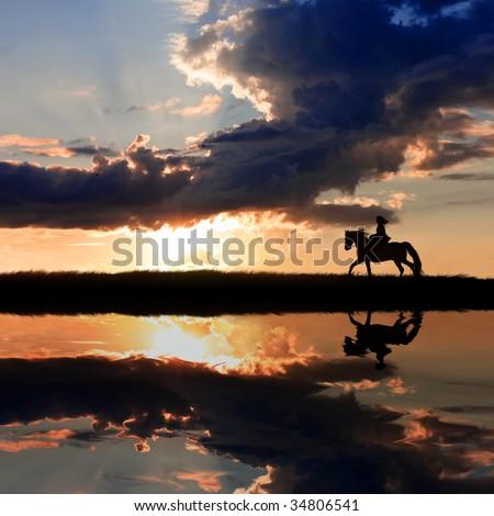 Horseback riding on coastline on sunset