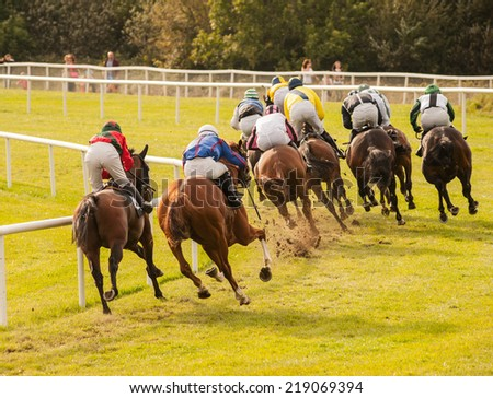 horses racing down the track