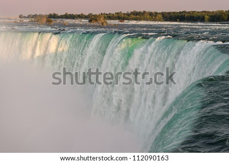 Horseshoe Falls as viewed from Table Rock in Queen Victoria Park at twilight in Niagara Falls, Ontario, Canada