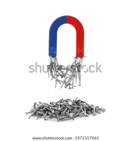 Horseshoe magnet attracting nails on white background #1471557965