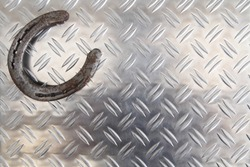 Horseshoe on a metal plate