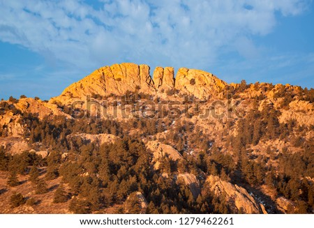 Horsetooth rock formation  at sunrise is a distinctive geological and popular mountain landmark overlooking Fort Collins, Colorado  Photo stock ©