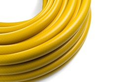 Hose for watering yellow color. Garden hose in a skein. Isolated on a white background.
