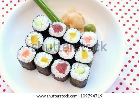 Hosomaki sushi  tuna, smoked salmon, cucumber and vegetables inside