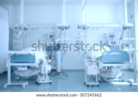 Hospital background. Defocused image of a hospital ward (ICU) with patients on beds