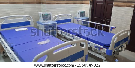 hospital beds, with bed side lockers, and patient monitor's #1560949022