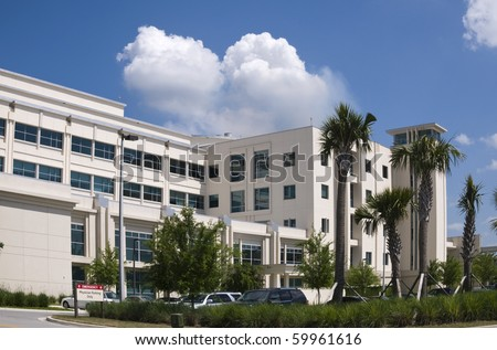 Hospital building showing Physician parking with blue sky