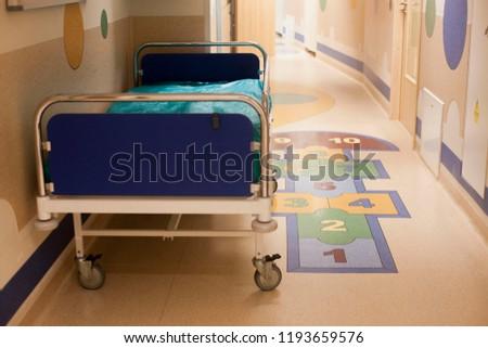 Hospital corridor and hospital bed #1193659576