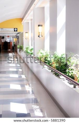 Hospital corridor leading to a reception area