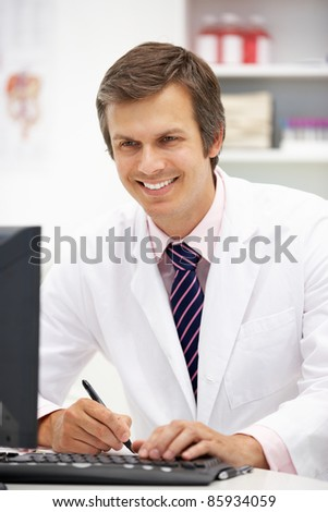 Hospital doctor at desk - stock photo
