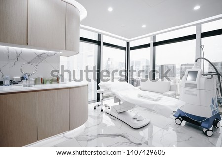 Hospital interior with operating surgery table, lamps and ultra modern devices, technology in modern clinic. Photo stock ©