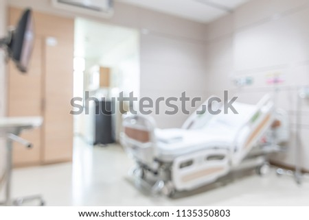 Hospital patient ward or ICU intensive care unit blur background with blurry medical empty bed room interior for nursing care and health treatment service backdrop
