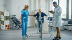 Hospital Physical Therapy: Portrait of Strong Senior Female Patient with Injury Successfully Walks Holding Parallel Bars. Physiotherapist, Rehabilitation Doctor, Help, Assist Disabled Patient