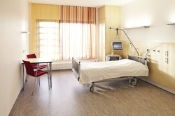 Hospital room in the hospital with bed and table