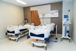 Hospital room with beds and comfortable medical equipped in a modern hospital. Treatment, coronavirus, pandemic, COVID-19