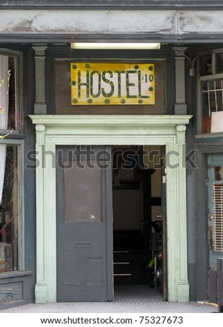 Hostel sign above a door