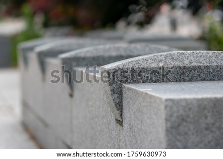 Hostile architecture - concrete bench with spike barriers to prevent people from sleeping. Photo stock ©