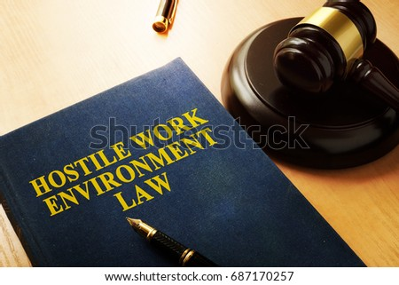 Hostile work environment law on an office table. Photo stock ©
