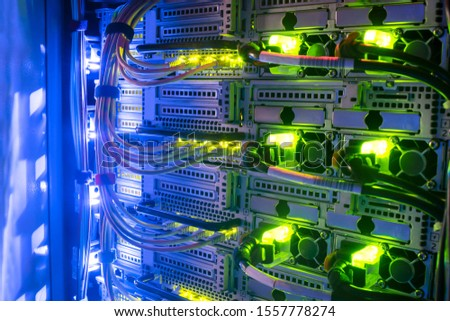 Hosting platform for modern Internet resources. Rack with server data storage equipment. Many network cables are connected to the data center equipment. Foto stock ©