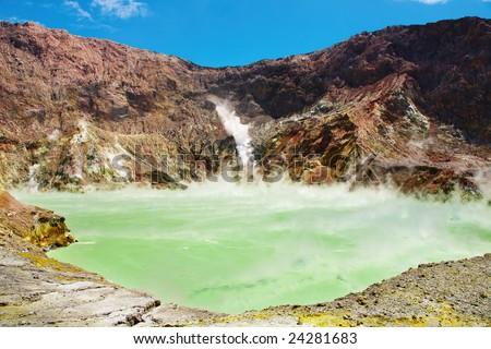 Hot acid lake in volcanic crater, White Island volcano, New Zealand