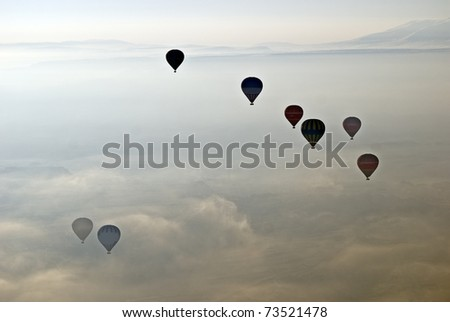 Hot Air Ballons flying on the sky of Cappadocia.Turkey.