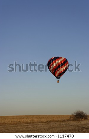 Hot Air Balloon about to land - stock photo