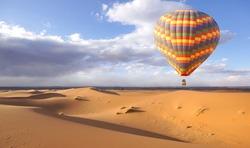 hot air balloon above the desert