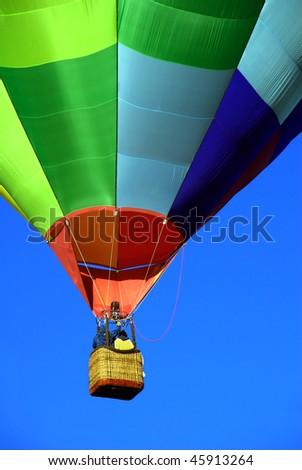 Hot air balloon against brilliant blue sky